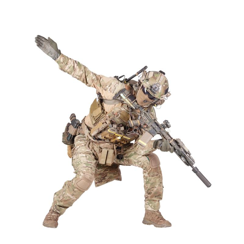 Army soldier going in attack isolated studio shoot. Army soldier, modern combatant, fireteam sergeant in battle uniform and helmet, armed with service rifle royalty free stock photography