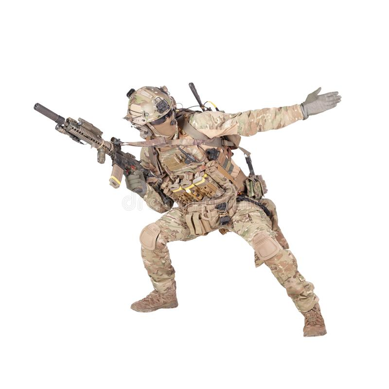 Army soldier going in attack isolated studio shoot. Army soldier, modern combatant, fireteam sergeant in battle uniform and helmet, armed with service rifle stock photos