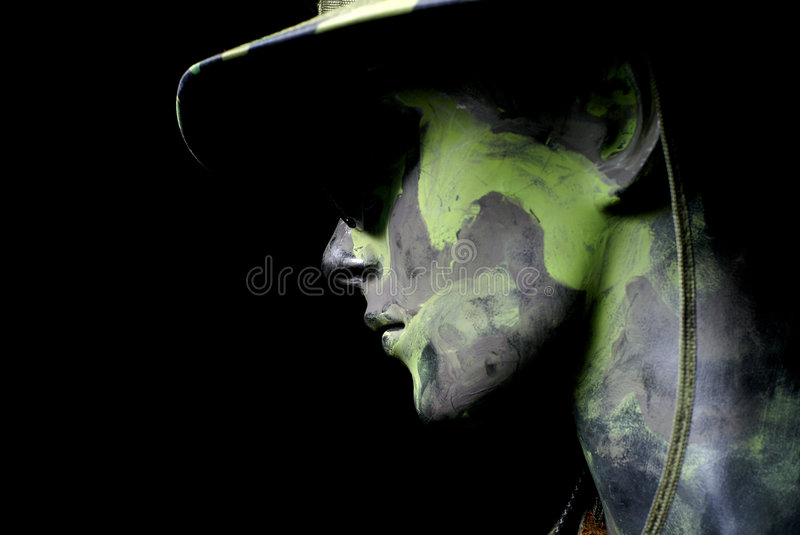Army soldier portrait. Army soldier dummy camouflage portrait with black background stock image