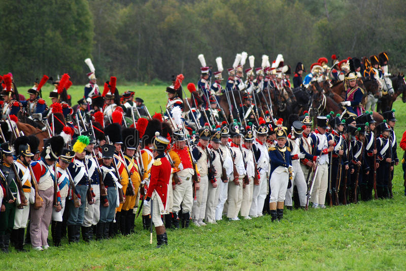 Army soldiers at Borodino battle historical reenactment in Russia. BORODINO, MOSCOW REGION - SEPTEMBER 04, 2016: Reenactors dressed as Napoleonic war soldiers at stock photos