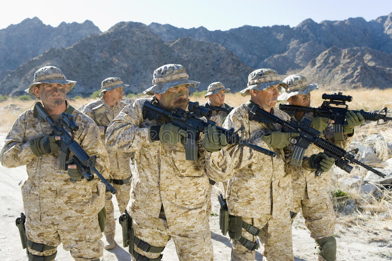 Army Soldiers With Rifles On A Mission royalty free stock photo