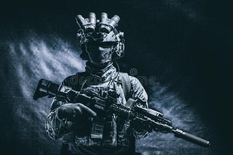 Army special forces fighter low key studio shoot. Half length, low key studio shoot of army soldier, marine infantryman in mask, camo uniform, equipped modern stock image