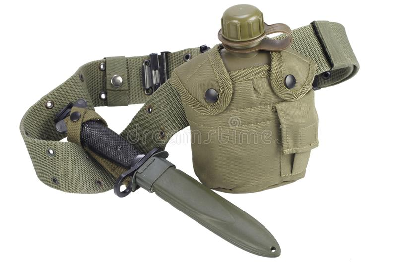 Army water canteen with bayonet and pistol belt. Isolated stock photography
