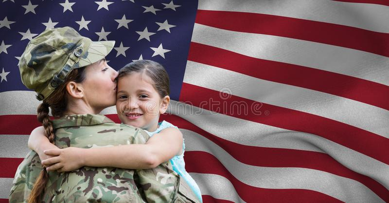 Army woman embracing her daughter royalty free stock photo