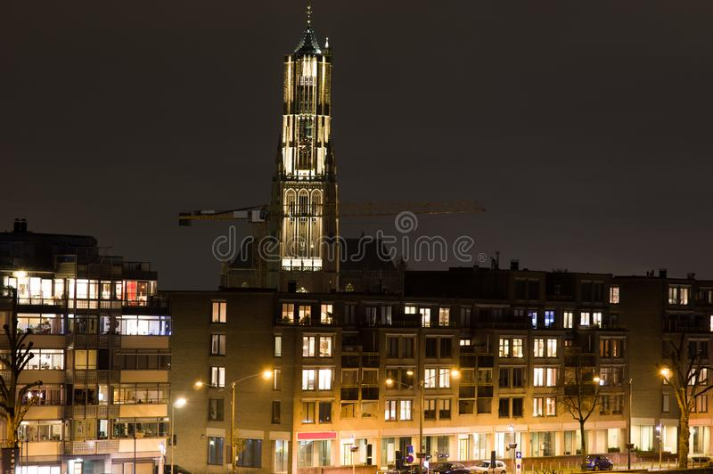 Arnhem in the Netherlands, with St. Eusebius church at night. St. Eusebius church at 93 metres is the largest church, and the largest building in Arnhem royalty free stock photography