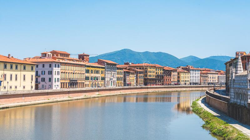 Arno river through the city of Pisa, Italy from the Solferino Bridge. Views of the Arno river through the city of Pisa, Italy from the Solferino Bridge royalty free stock photos
