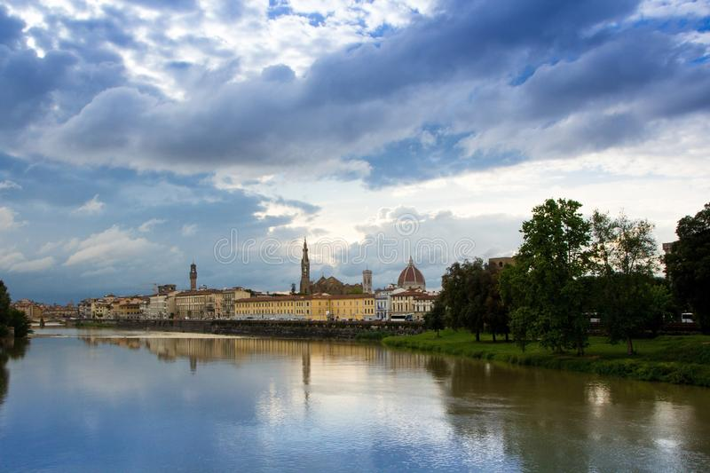 The Arno river and the cloudy Florence. View of the Cathedral of Santa Maria del Fiore, the Basilica of Santa Croce. royalty free stock photo