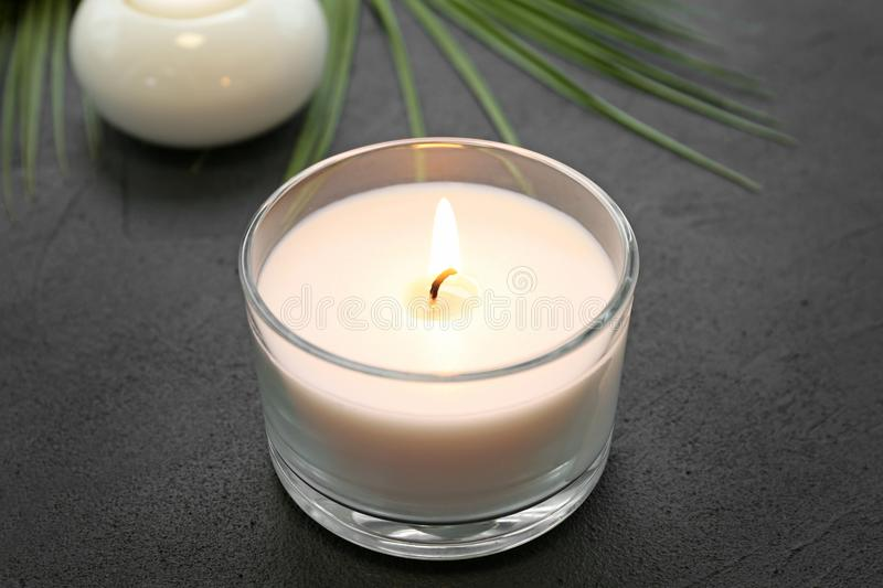 Aroma candle on grey background, closeup. Spa setting royalty free stock photos