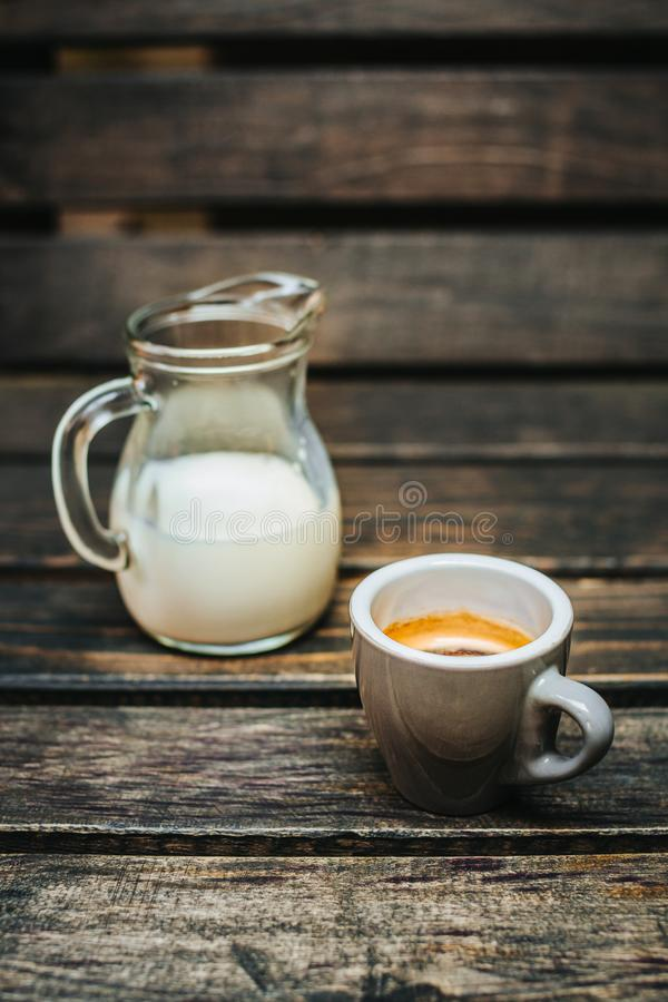 Aroma coffee cup with roasted beans on vintage old background royalty free stock image