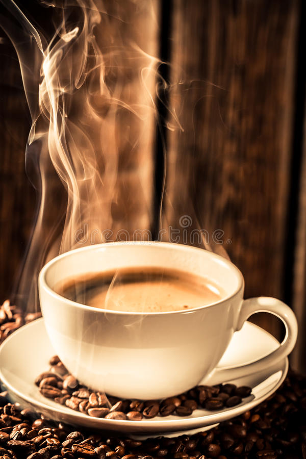 Aroma coffee cup with roasted seeds royalty free stock photo