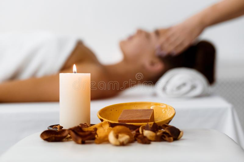 Aroma composition with candle and relaxing woman stock images