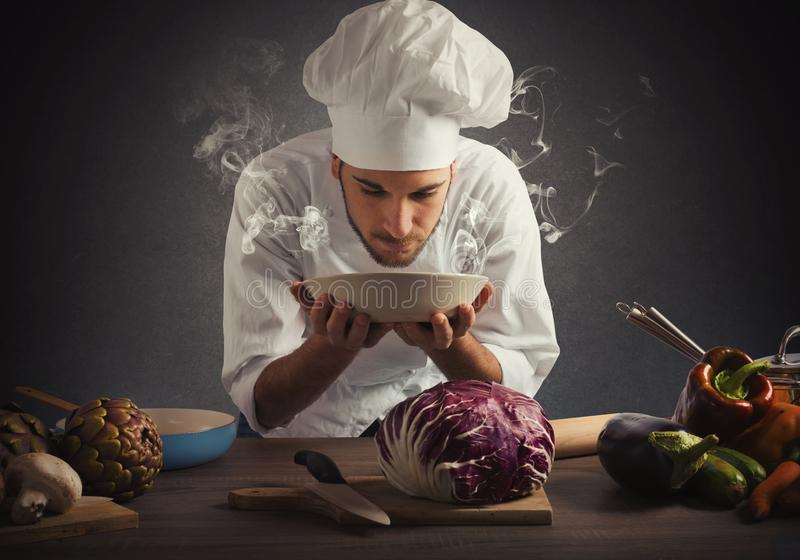 Aroma of a dish. Chef smelling the aroma of a dish stock photos