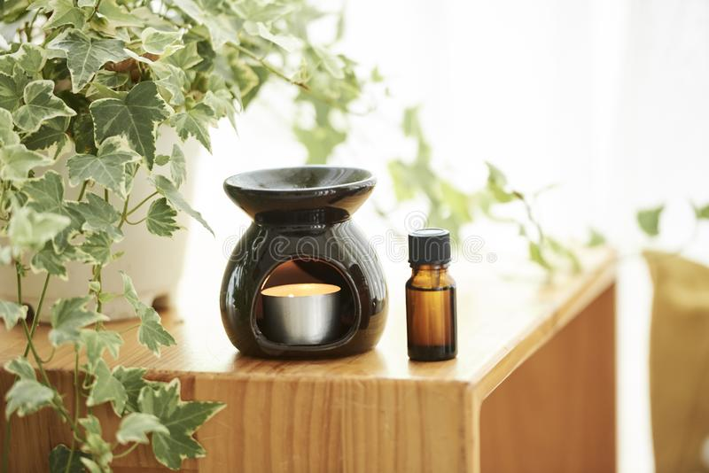 Aroma lamp and essential oil stock photo