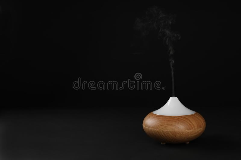 Aroma oil diffuser on black background royalty free stock photo