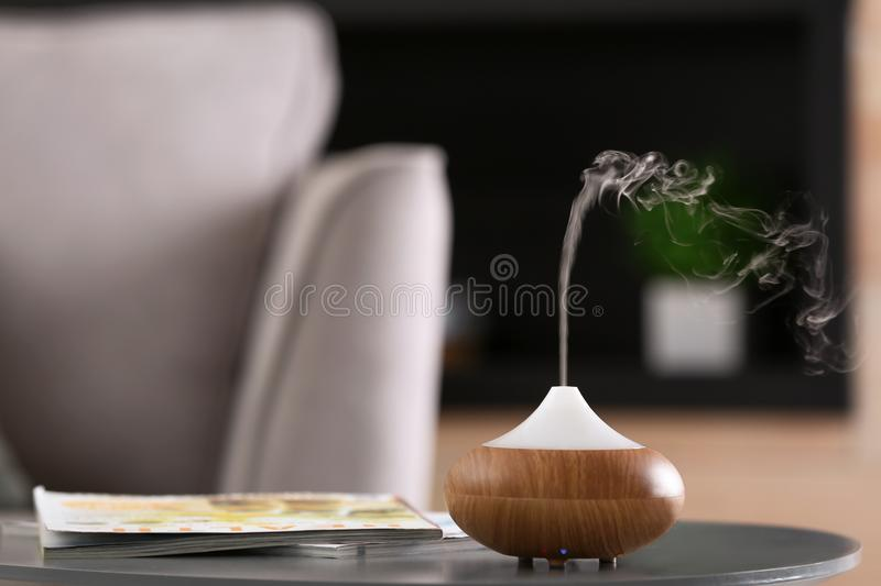 Aroma oil diffuser lamp on table royalty free stock photos