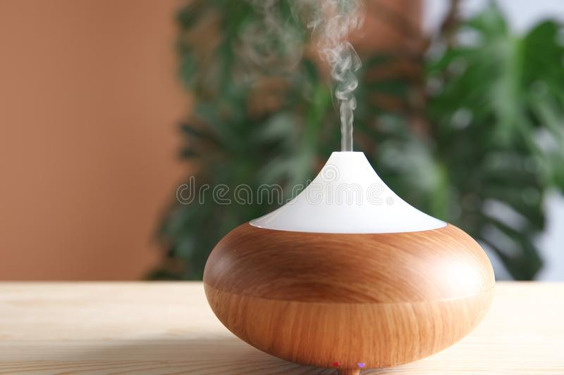 Aroma oil diffuser on table stock photo
