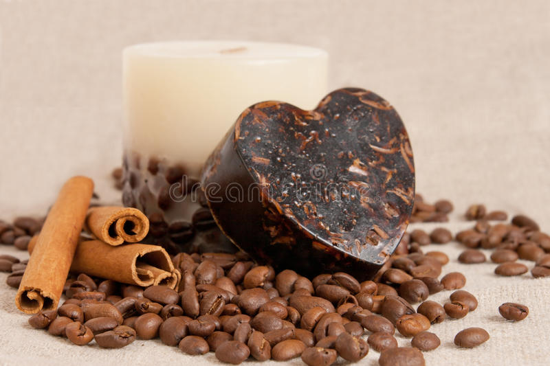 Aroma soap, candle with cinnamon sticks and coffee royalty free stock photos