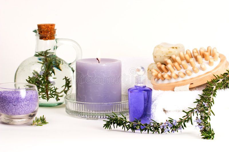 Aroma spa set. Spa set - aroma candle, salt, oil and organic soap - with rosemary best suited for relaxing and health commercials stock photo