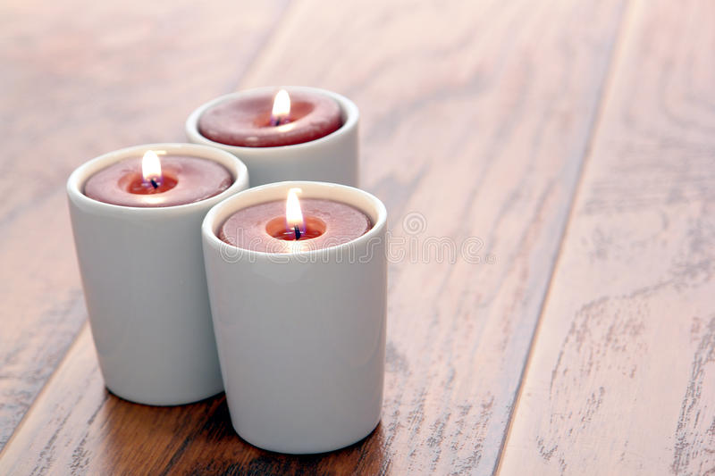 Aromatherapy Candles Burning on Wood Table royalty free stock images