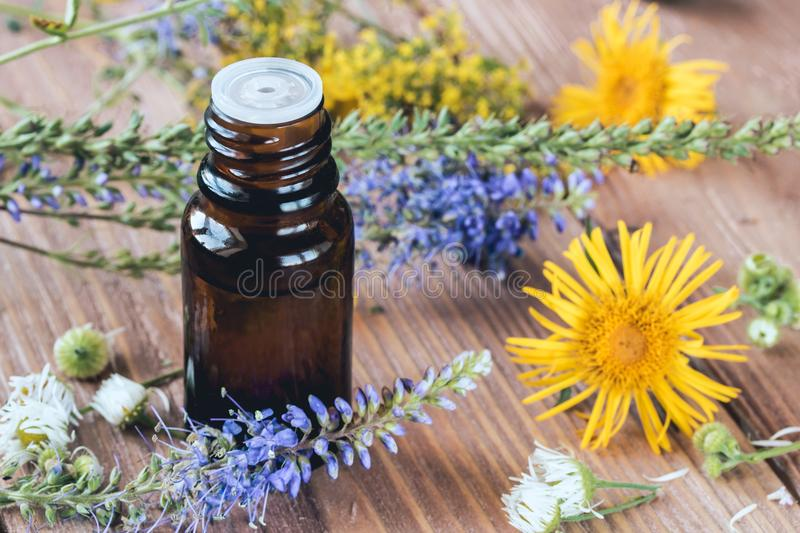 Aromatherapy with essential oils from citrus herbs and flowers. Aromatherapy with essential oils from citrus herbs and flowers on a wooden table stock photo
