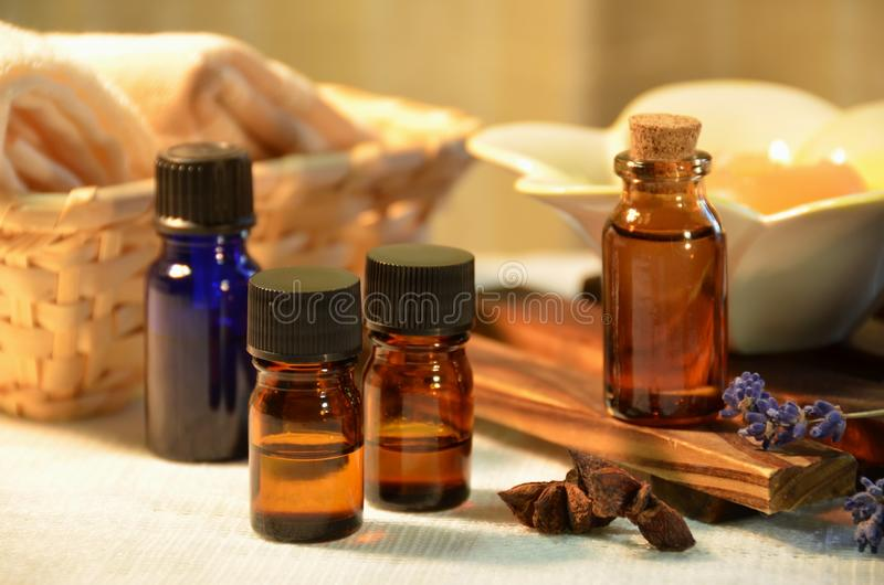 Aromatherapy oils in candle light stock photography