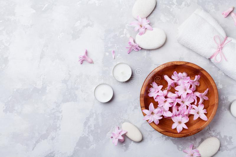 Aromatherapy, spa, beauty background with massage pebble, perfumed flowers water and candles on stone table top view. Flat lay. Aromatherapy, spa, beauty stock photos