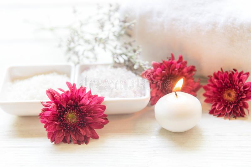 Aromatherapy Spa with candle and red flower spa and rolled towel. Thai Spa relax Treatments and massage white background,. Select focus.  Healthy Concept stock photos