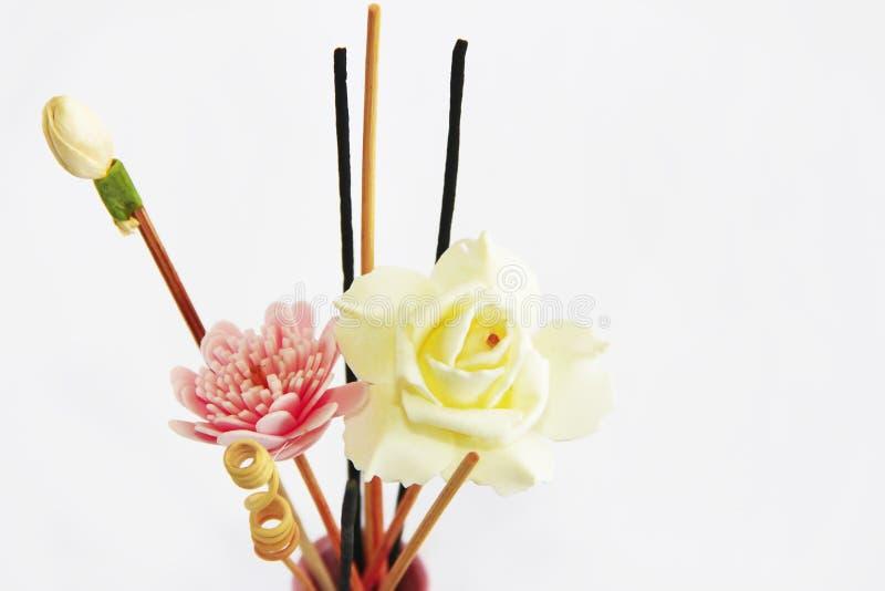 Aromatherapy sticks and decorative artificial flowers in pink ceramic vase. Aromatherapy sticks and decorative artificial flowers in a pink ceramic vase stock photos