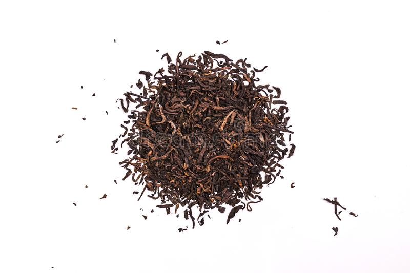 Aromatic black pu-erh tea leaves, a pile of dry red chinese pu-er, close-up, isolated on white stock photos