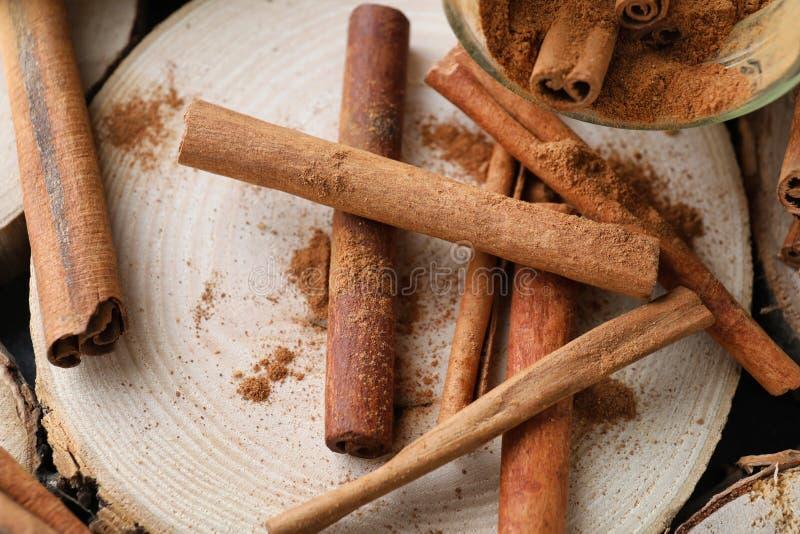 Aromatic cinnamon sticks on wooden background, closeup stock image