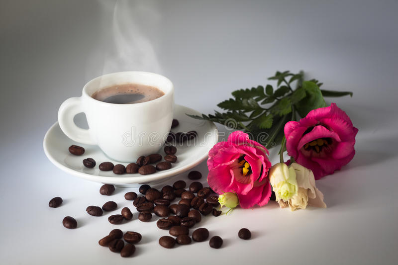 Aromatic coffee with floral decor royalty free stock images