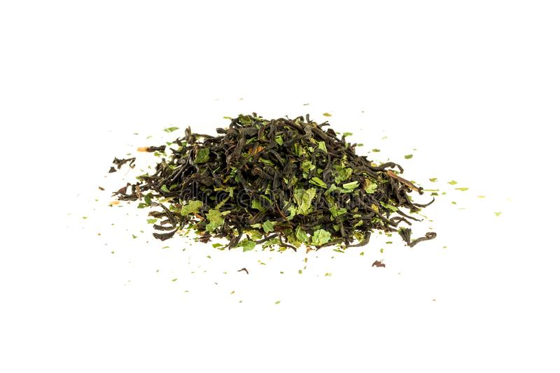 Aromatic crumbly Handful of Dry tea leaves isolated on white background. Green and black dry tea, isolated on white royalty free stock photo