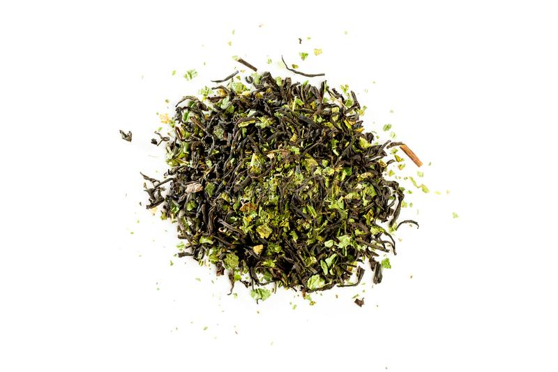 Aromatic crumbly Handful of Dry tea leaves isolated on white background. Green and black dry tea, isolated on white royalty free stock photography