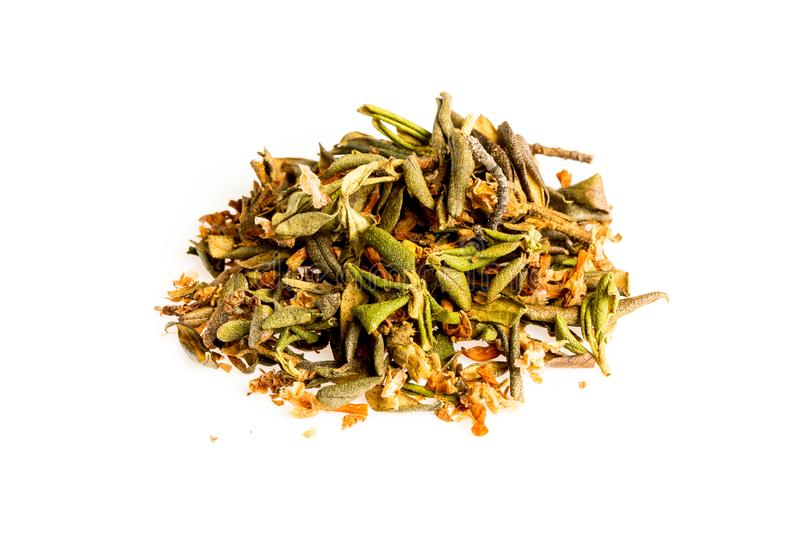 Aromatic crumbly Handful of Dry tea leaves isolated on white background. Green and black dry tea, isolated on white stock image