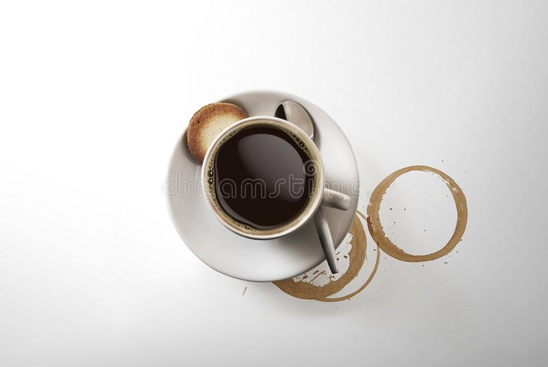 Aromatic cup of Cappuccino coffee, on a saucer, with a spoon, shot from above on white, with a drop shadow stock photography