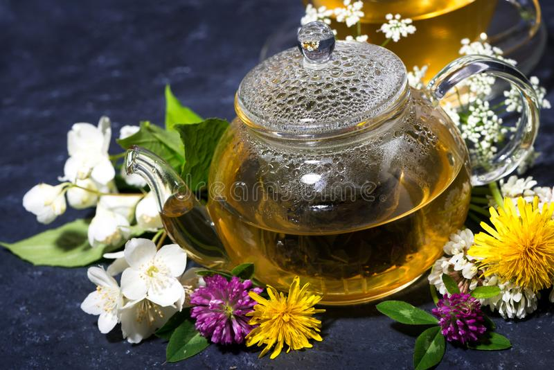 Aromatic flower tea and honey in a teapot. Closeup stock image