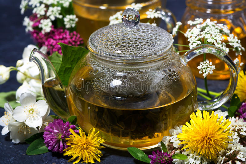 Aromatic flower tea and honey in a teapot, closeup. Horizontal stock images