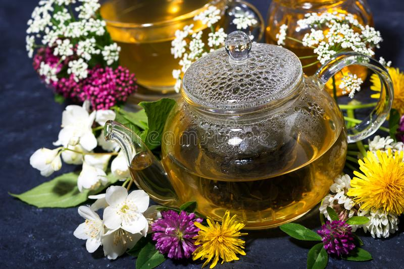 Aromatic flower tea and honey in a teapot, top view royalty free stock photos