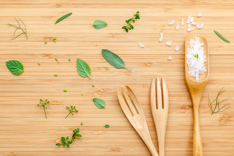 Aromatic herbs and spices green mint ,fennel ,oregano, sage,lem. On thyme and peppermint with fork and spoon on rustic wooden background . Healthy food concept royalty free stock images