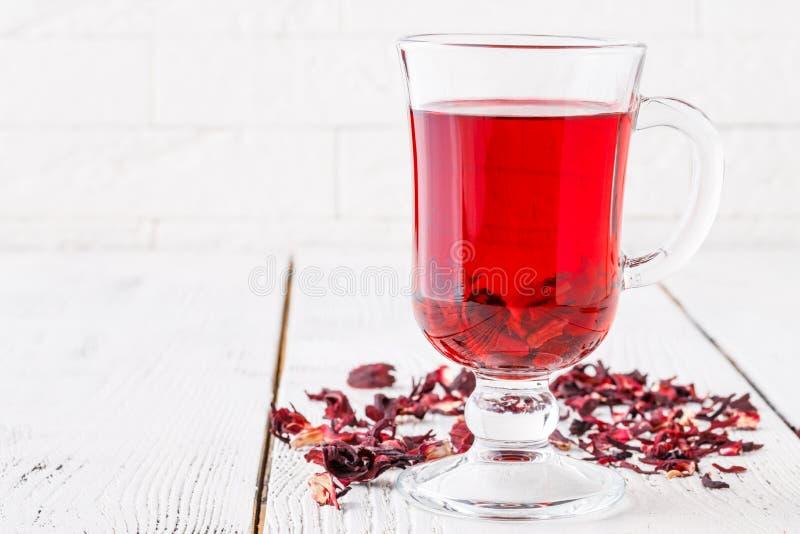 Aromatic Hibiscus tea on white table royalty free stock photo