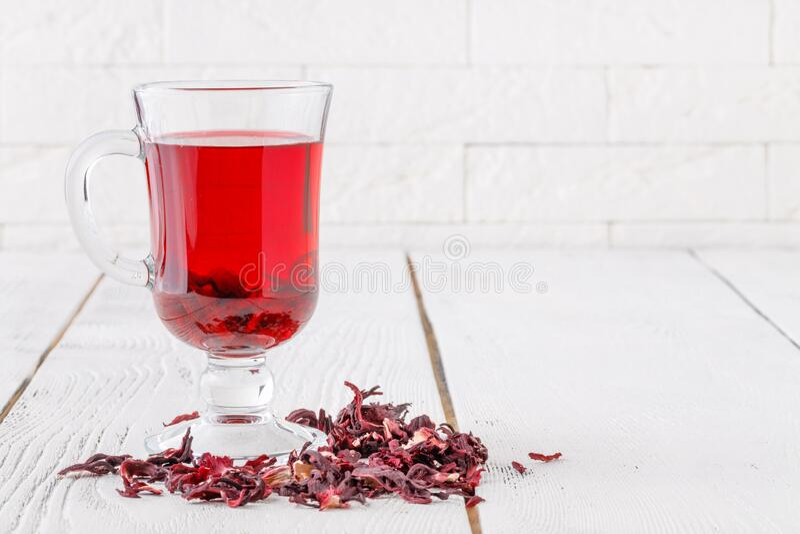 Aromatic Hibiscus tea on white table stock photo