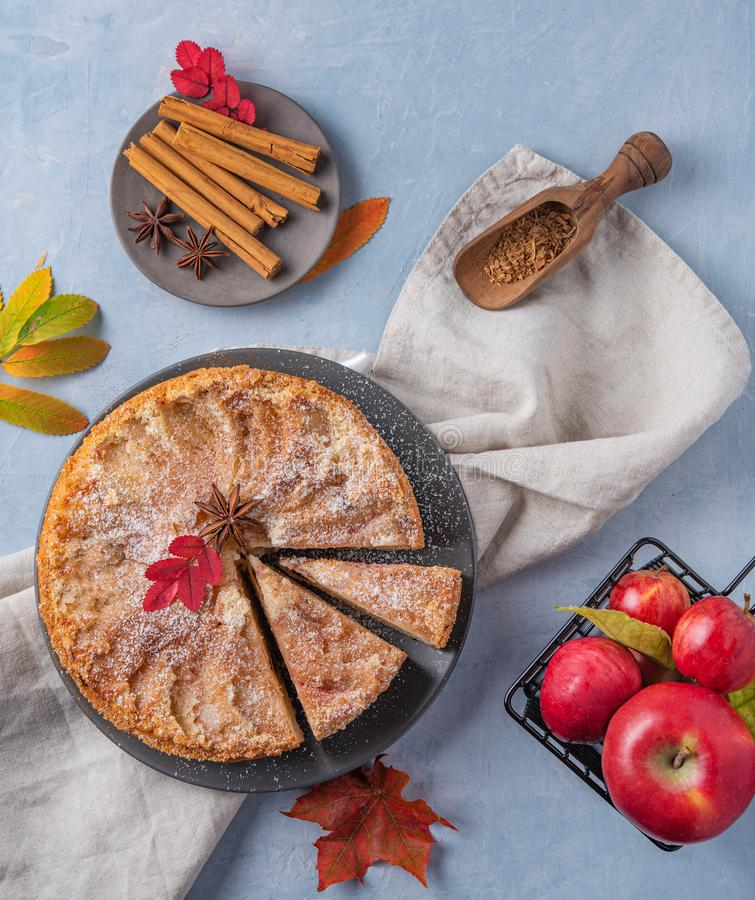 Aromatic homemade apple pie with red apple and cinnamon on wood blue table autumn. Top view stock image