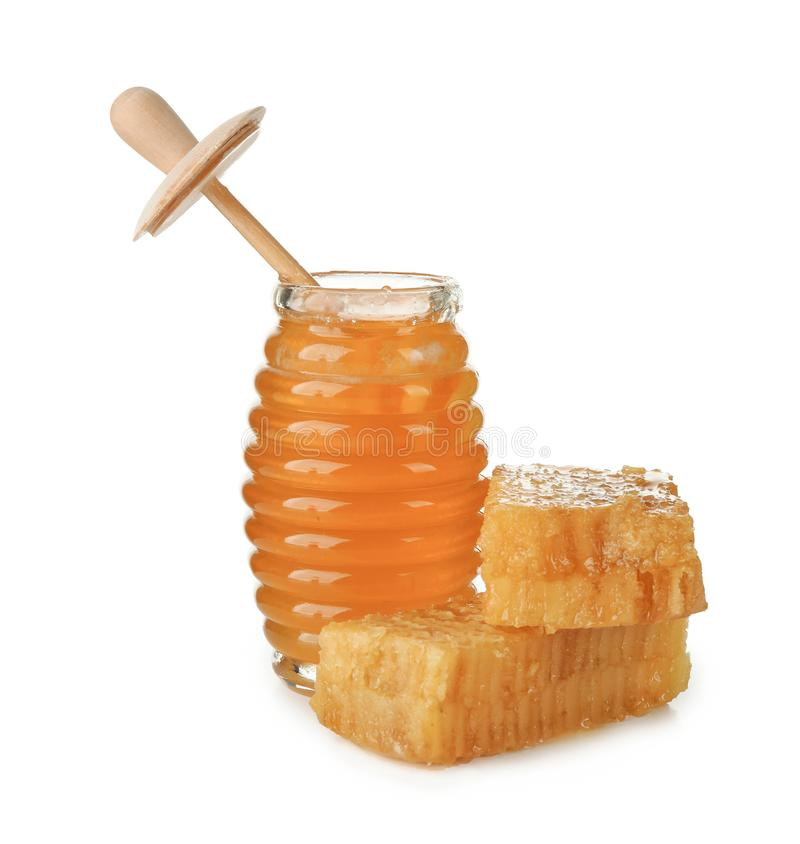 Aromatic honey in jar and honeycomb. S on white background stock photos