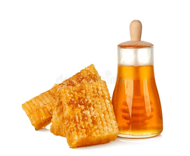 Aromatic honey in jar and honeycombs. On white background royalty free stock images