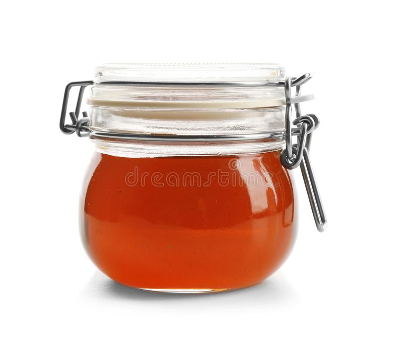 Aromatic honey in jar, isolated royalty free stock image