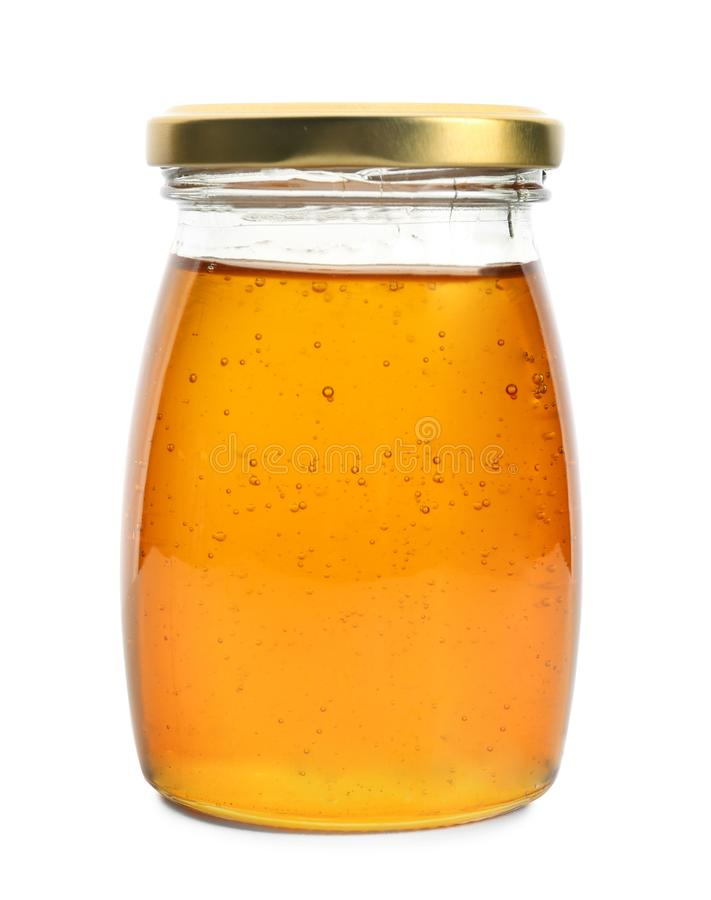 Aromatic honey in jar, isolated royalty free stock images