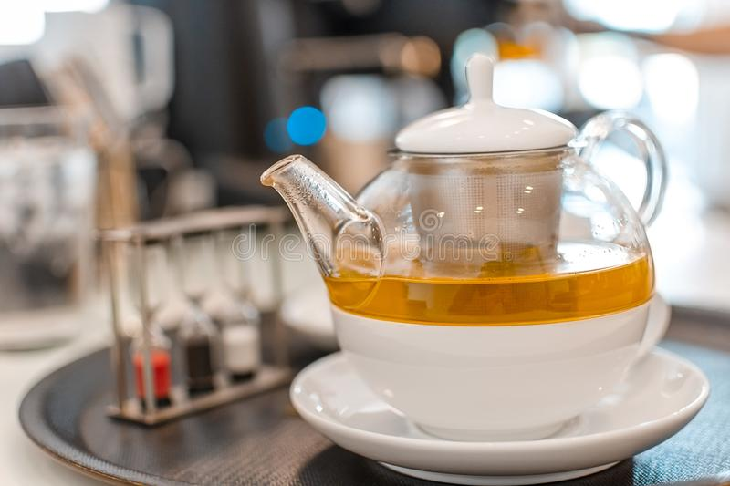 Aromatic hot cup tea on wooden table. In cafe shop royalty free stock photos