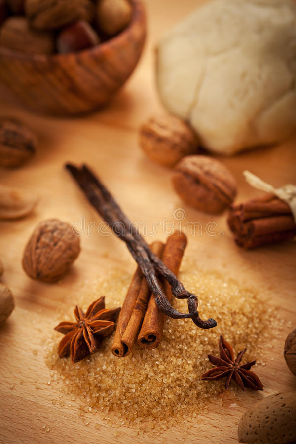 Aromatic ingredients for baking Christmas cookies. In brown stock images