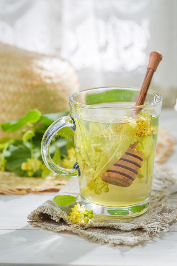Aromatic linden tea with honey in old kitchen. On old table royalty free stock image