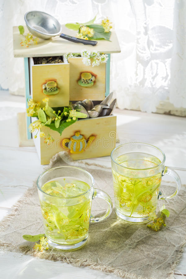 Aromatic linden tea with honey in spring day. On old table royalty free stock photography